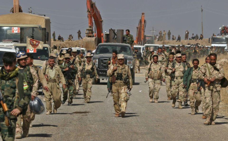 957686-des-combattants-peshmergas-avancent-en-direction-de-nawran-a-10-km-au-nord-est-de-mossoul-pour-prend1