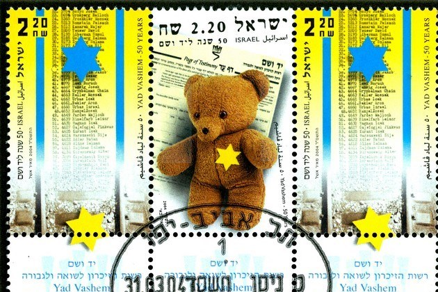 L'étoile jaune sur un timbre israélien, émis pour le cinquantenaire de Yad Vashem en 2003